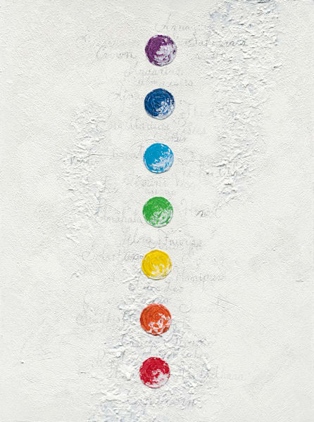 A rainbow of chakras on a pale textured ground.