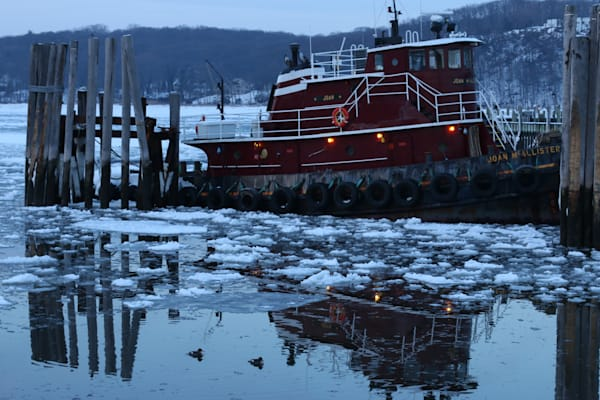 Boat Reflection in Water in Port Jefferson Harbor by Steven Archdeacon.