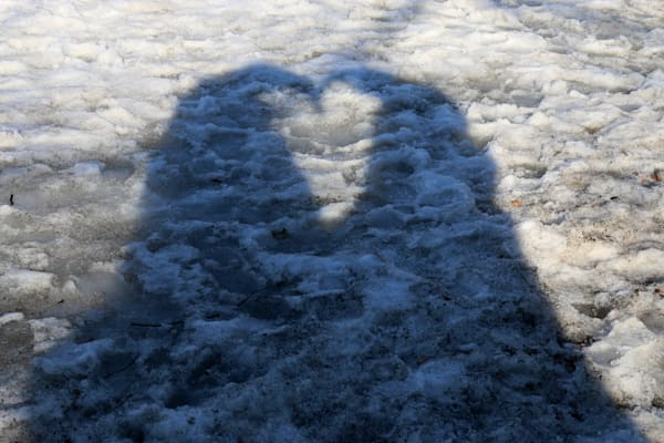 Creative Photographs forming a Heart with human shadows by Steven Archdeacon.