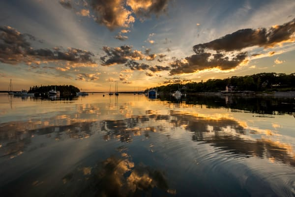 Sorrento harbor at sunset, with mirror reflection of clouds, in fine art photograph