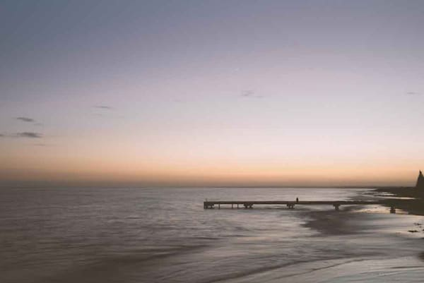 Peaceful and tranquil sunrise fine art photograph at Busselton Jetty.