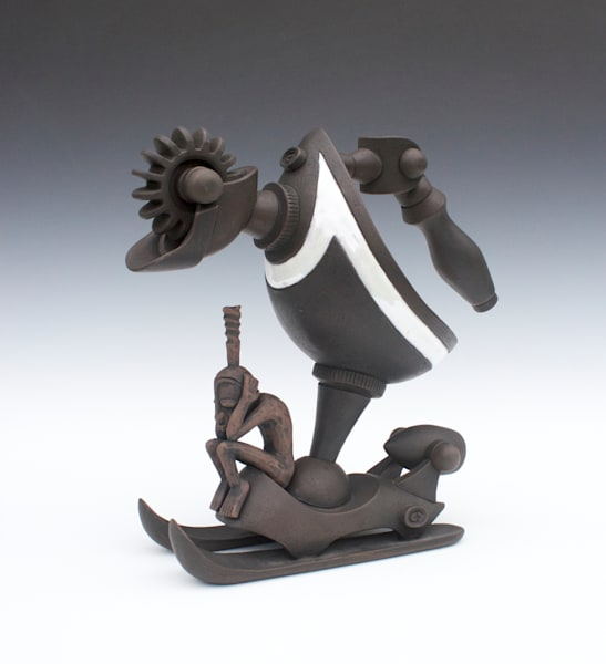 hydraulic sled with contemplative power and african inspired figure