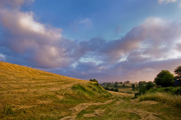 Clouds at Sunrise Over Newly Mown Hayfield