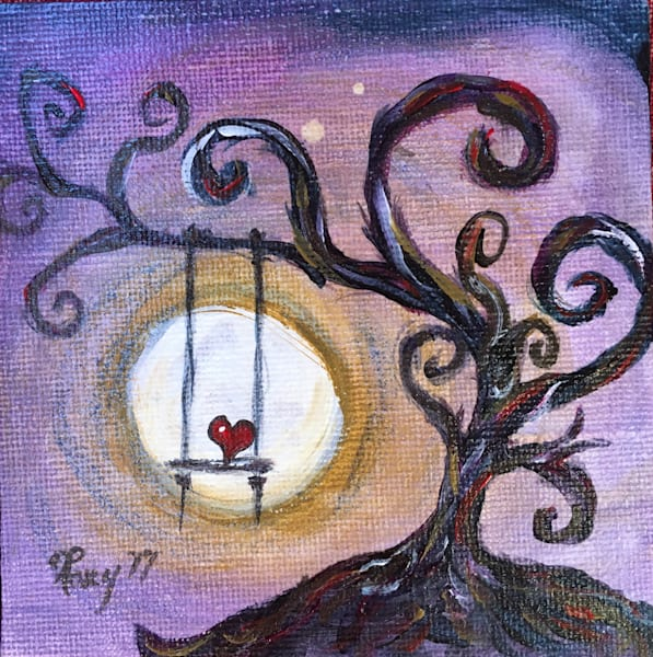 Whimsical heart swinging from a tree