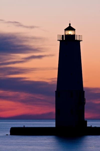 Colorful sunset over the Frankfort North Breakwater Lighthouse