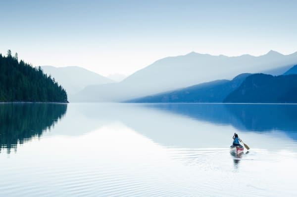 An early-morning paddle on Slocan Lake, Kootenays, BC
