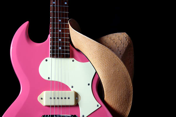 Cowgirl hat on pink guitar Image 024h