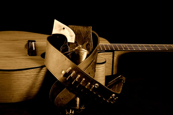 Six Gun in Holster and Guitar Image in Sepia 356bw