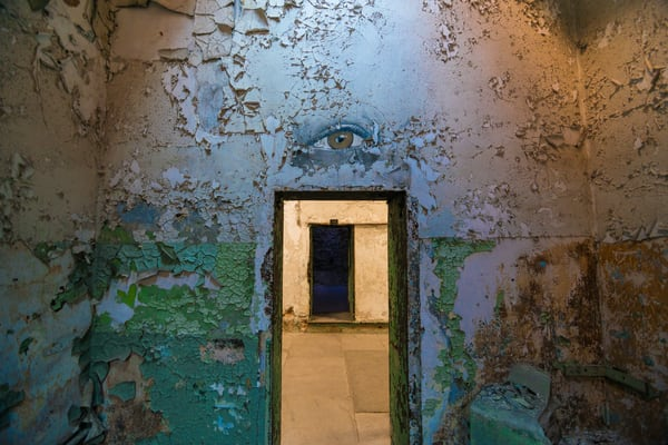 prison cell with art of an eye