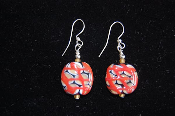 Red, Tan, White and Black Infused Glass Earrings by artists Sage and Tom Holland.