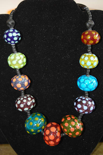 Multicolored Fused Glass Ball Necklace crafted by artists Sage and Tom Holland.