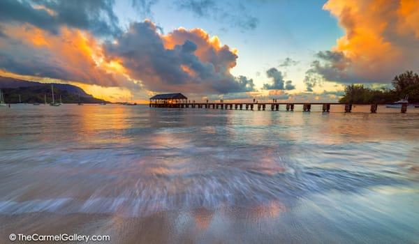 photo of sunset over Hanalei Pier