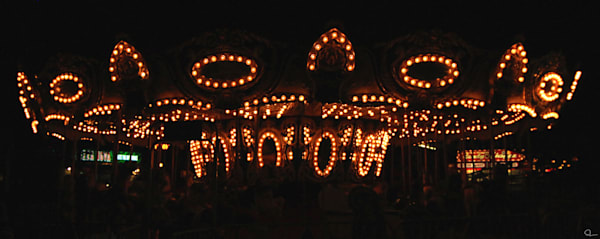 photograph of a lighted antique carousel ride available for sale from Michael Toole.