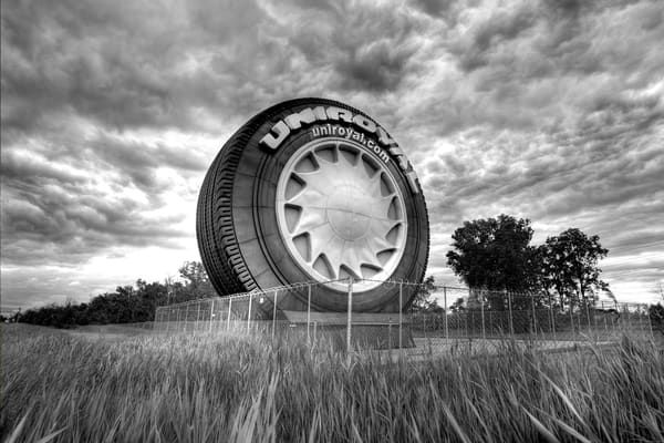 The Big Tire On I 94 (Monochrome) Photography Art by lancerosol
