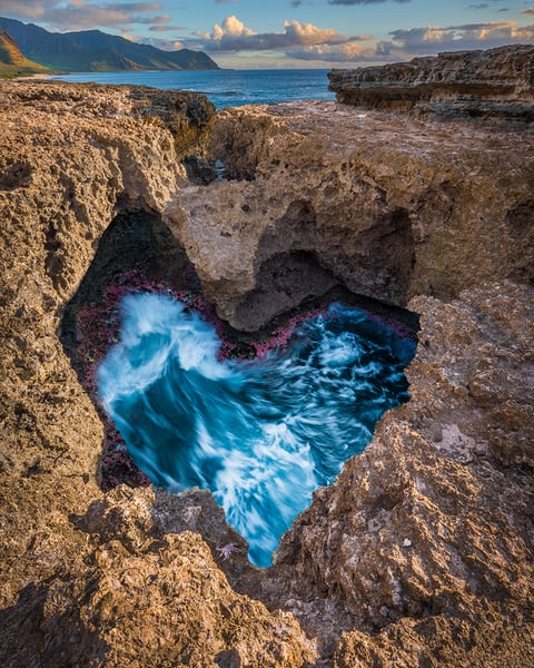 Dramatic color photo of swirling tide pool in heart shape