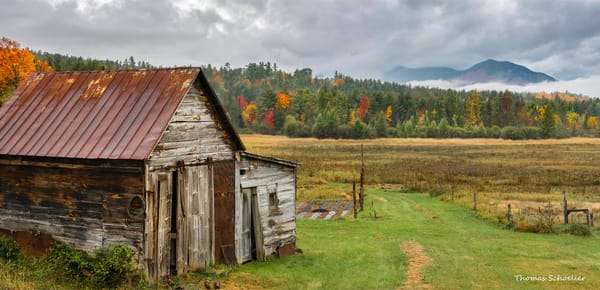 The High Peaks region of the Adirondacks | Weathered Jay NY barn during peak autumn foliage season
