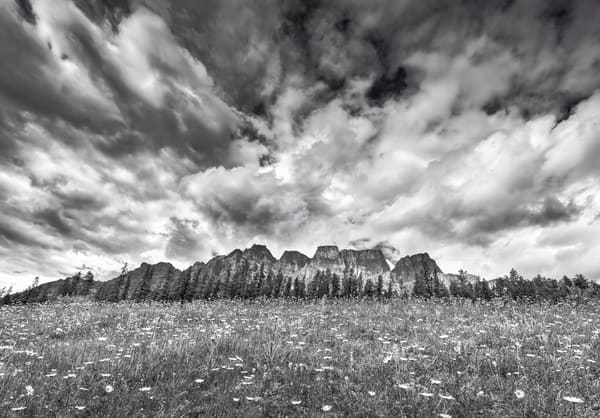 Clouds stream over the peaks of Castle Mtn.|Banff National Park|Canadian Rockies|Rocky Mountains|