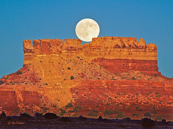 Moon on Butte in Canyonlands National Park, Utah