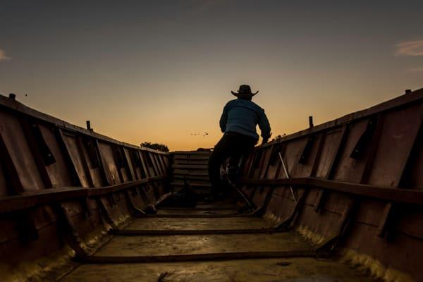 Sunrise canoe with cowboy