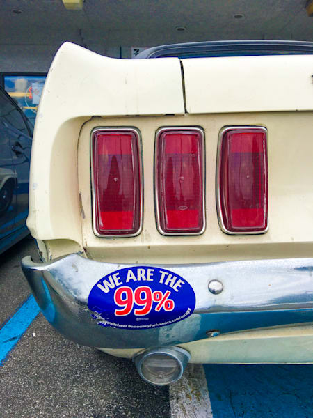 """Bumper Sticker """"We Are The 99%"""" on Ford Mustang - 8226"""