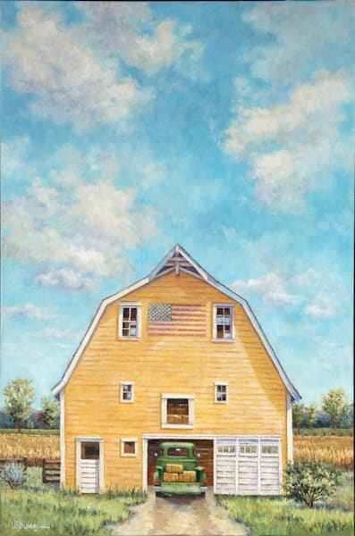 A nostalgic yellow barn, welcoming home the farmer in his green pickup after a hard days work