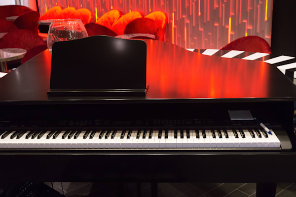 Photograph of a Piano, Colorful Abstract Light on beautiful black piano.