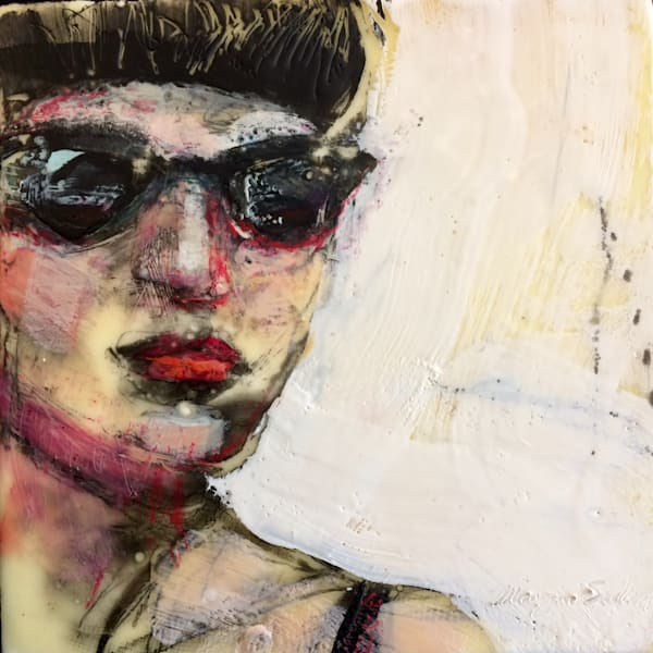 Portrait of dark haired woman with black sunglasses