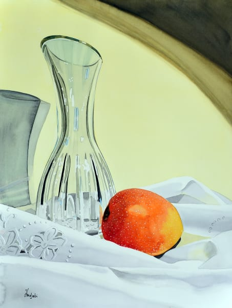 Let there be light - A still life of a mango and a crystal decanter on fine white linen