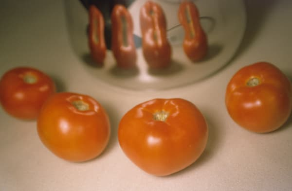 Four Red Ripe Tomatoes With Reflection