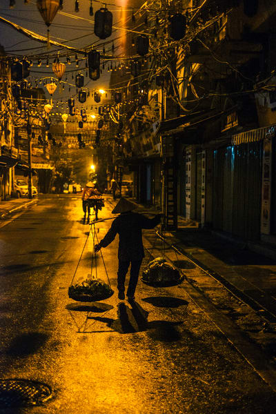 Fine Art Prints, Man walking at night in Hanoi, Vietnam