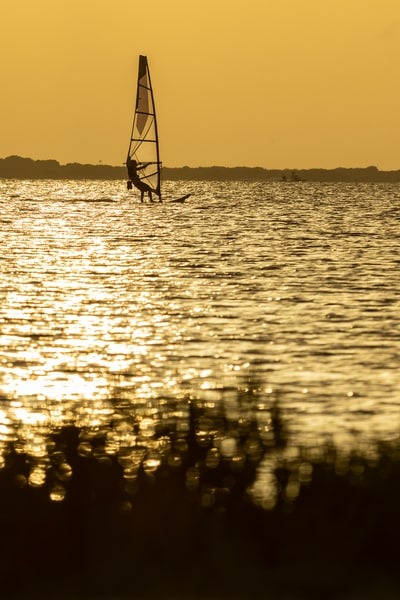 Silhouette of a windsurfer in the sunset Photographs – Fine Art Prints