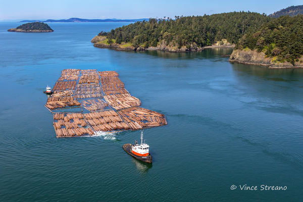 Fine art prints of tug boat pulling a log boom in Deception Pass, WA.