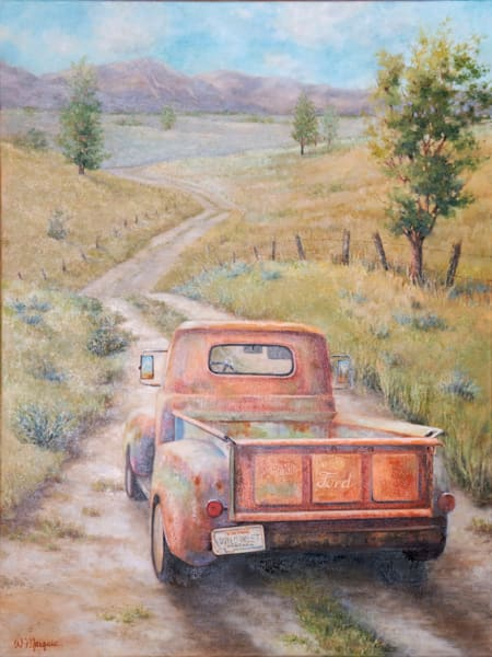 Old Orange ford on a country dirt road