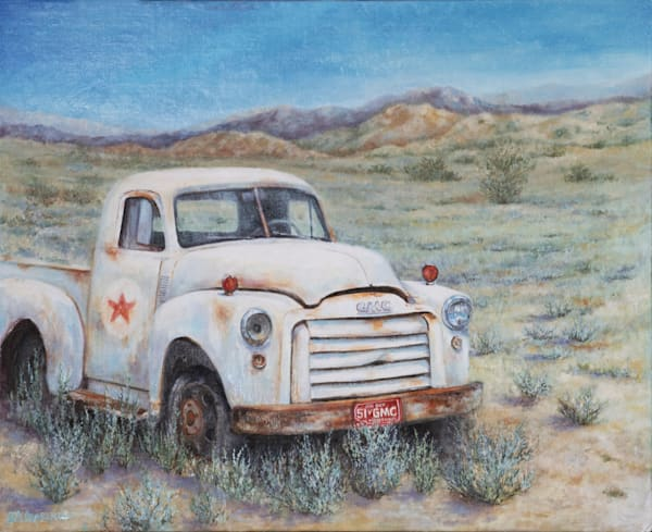 The Last Mile, a white gmc pickup out in a field of sage.