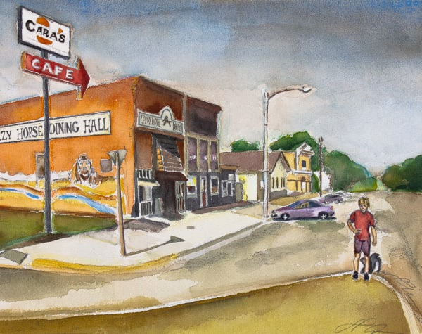 A young boy looks toward the viewer from downtown Arlington, Kansas while sunset lights up the beautiful Crazy Horse Dining Hall behind him. Available in paper, acrylic and canvas.