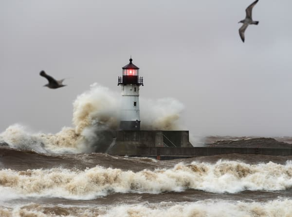 Waves crashing into Duluth's Canal Park Lighthouse