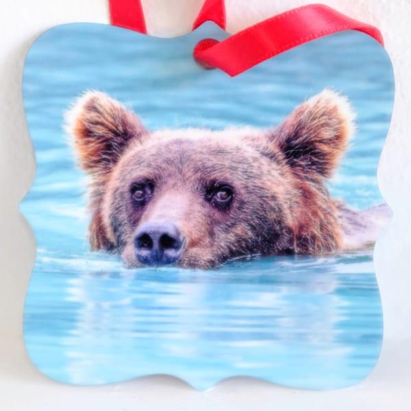 Alaskan brown bear in water metal ornament