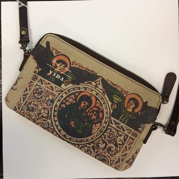 Striking Armenian  illuminated manuscript of Mary and Jesus, Madonna and Child  printed on a well crafted canvas and leather strap bag. Pictured here with the large iPhone * plus (not included) so you can see you still have room for a large phone, m