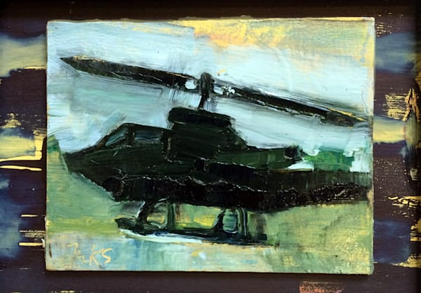 """Original plein air oil painting, """"Joyride 20-Cobra Helicopter"""" painted at the Helicopter Museum in West Chester, PA, Measures 5x7"""", oil and mixed media on wood, framed with a white wood frame."""