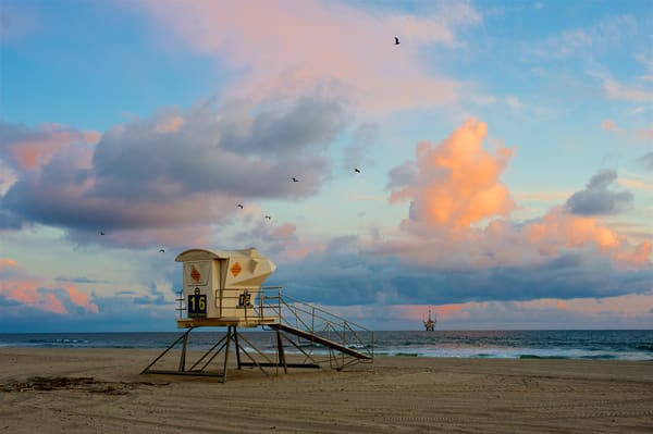 A lifeguard stand in Huntington Beach at sunset.