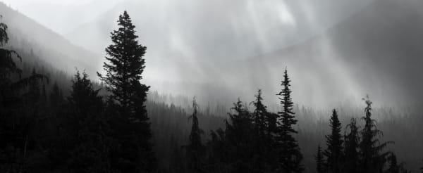 Sun rays bursting thru morning storm clouds