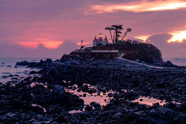 Fine Art Print of Battery Point Lighthouse as clouds clear during a stormy sunset over Crescent City, California
