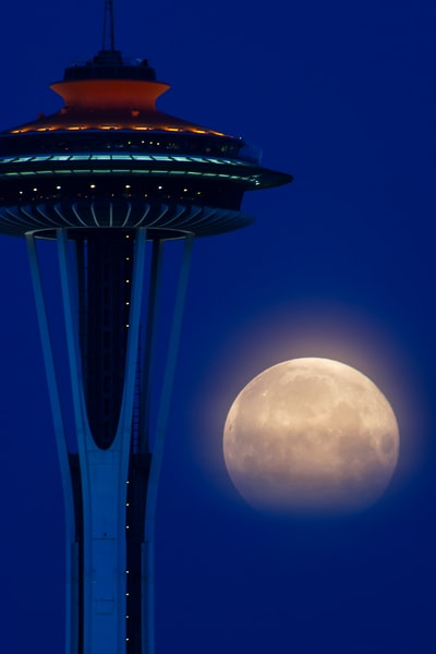 Full moon and Space Needle from Fairview Av E