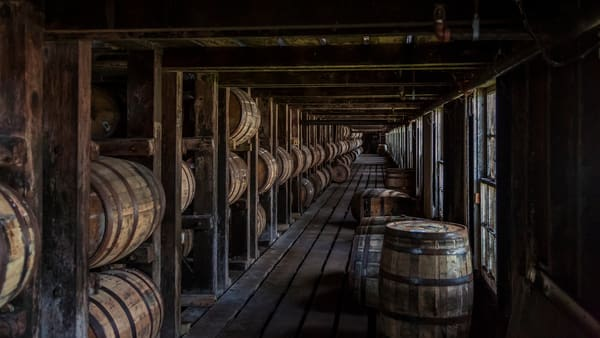 Vanishing point Fine Art print of a Kentucky bourbon rickhouse full of aging oak barrels.