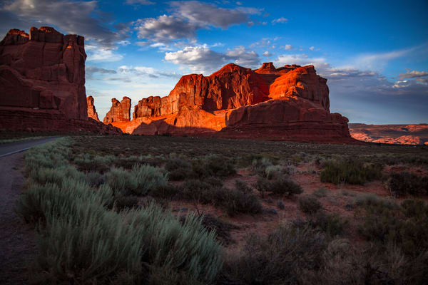 Fine Art print of sunset bringing shadows and vibrant colors to Park Avenue in Arches National Park, Moab, Utah