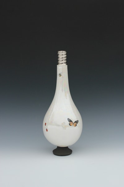 large light bulb vase with two lady bugs