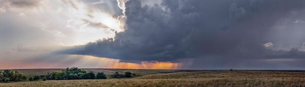 Panoramas/Wide View - color | Storm over the Kansas Flint Hills - color. The sun peaks behind a prairie thunderstorm. Photo by David Zlotky.
