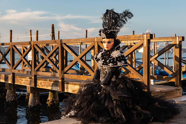 Carnevale Model on a Venetian Bridge