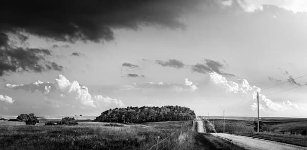 Panoramas/Wide View - bw | Back Road, the Kansas Flint Hills - bw. Wide view of the Kansas prairie as a thunderstorm builds in the distance. David Zlotky photograph.
