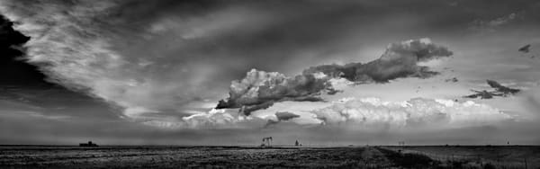 Storms Over the Prairie Collection - bw | Western Kansas Cloudscape - bw. Massive storm clouds dwarf an oil well. Fine art black and white photo by David Zlotky.